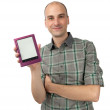 Happy young man holding E-book — Stock Photo