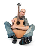 Man sits with a guitar — Stock Photo