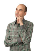 Man looking up at copyspace and thinking — Stock Photo