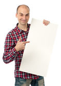 Handsome young man pointing at a blank billboard — Stock Photo