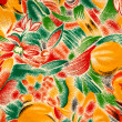 Abstract bright textile in batik's technique — Stock Photo