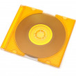 Yellow cd in the jewel case isolated on white — Stock Photo