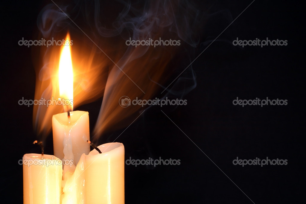 One burning candle between two just extinguished candles on dark background with free space for text — Stock Photo #6919896