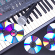 Vocal microphone,cd discs and electronic keyboard — Stock Photo