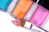 Professional make-up brush and tubes with colour pigment — Stock Photo