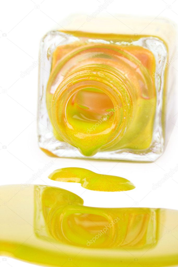 Spilled yellow nail varnish, closeup on white — Stock Photo #7623830