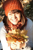 Woman with autumn orange leaves — Stock Photo