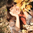 Woman with autumn leaves — Stock Photo #7542947