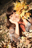 Woman with autumn leaves — Stock Photo