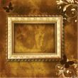 Golden picture frame on the grunge wall — Imagens vectoriais em stock