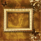 Golden picture frame on the grunge wall — Stock Vector