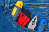 Set construction tools in pocket jeans. — 图库照片