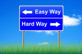 Easy way, hard way roadsign with arrows. Grass underneath. — Stock Photo