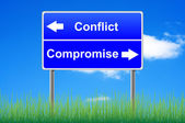 Conflict compromise roadsign on sky background, grass underneath — Stock Photo