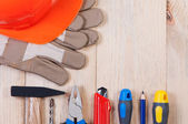 Construction tools on wooden board top view. — Stock Photo