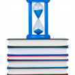 Stock Photo: Hourglass on pile of books isolated on white background.