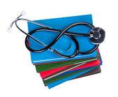 Medical stethoscope on pile books isolated. — Stock Photo