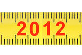 Ruler with numbers 2012 closeup isolated on white background. — Stock Photo