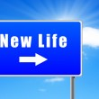 New life road sign with arrow on sky background. — Stock Photo #7810310