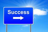 Success road sign with arrow on sky background. — Stock Photo