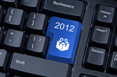 Button computer keyboard with icon gift and figures 2012. — Stock Photo