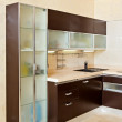Part of modern Kitchen interior with cupboard in warm tones — Stock Photo