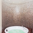 White round jacuzzi in modern bathroom with brown mosaic and cou — Stock Photo