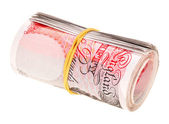 Pound sterling rolled up bank notes, isolated on white — Stock Photo