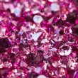 Many small ruby diamond stones, luxury background shallow depth - Stock Photo