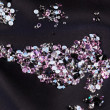 Diamond (small purple jewel) stones heap over black silk cloth b - Stock Photo