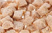 Many brown lump cane sugar cubes , food background — Стоковое фото