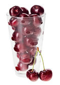 Red fresh wet cherry fruits in transparent glass, isolated on wh — Stock Photo