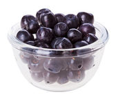 Bilberry fruit in transparent glass, isolated on white macro — Stock Photo