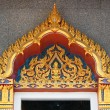Wooden door with gold in the Thai temple — Stock Photo