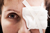 Plaster patch on wound eye — Stock Photo