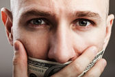 Dollar money gag shut voiceless man — Stock Photo