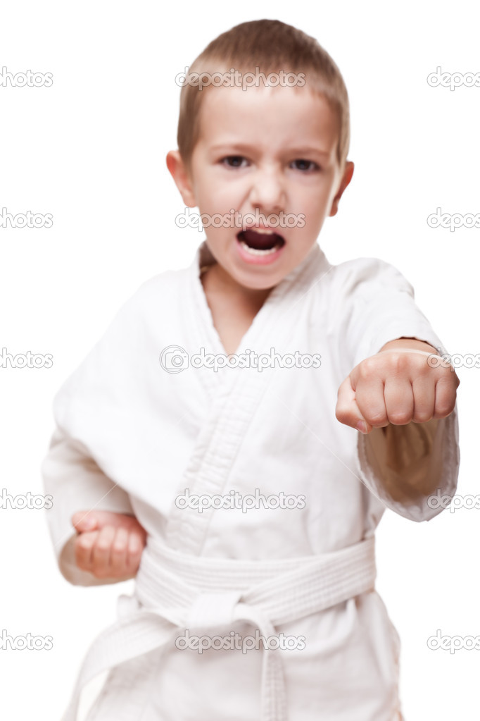 Martial art sport - child boy in white kimono training karate punch — Stock Photo #7641829