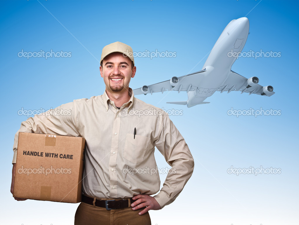 Smiling delivery man and cargo airplane — Stock Photo #6871466