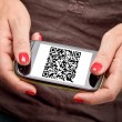 Qr code on smartphone - Stock Photo