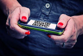Qr code on smartphone — Stock Photo