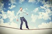Man walk on rope — Stock Photo