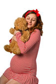 Beautiful pregnant girl hugging a toy — Stock Photo