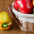 Fresh vegetables, peppers, tomatoes in basket — Stock Photo #7064327