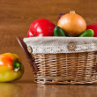 Fresh vegetables, peppers, tomatoes in basket — Stock Photo #7178479