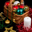 Christmas Decoration in basket and burning candle — Stock Photo