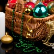 Christmas Decoration in basket and burning candles — Stok fotoğraf