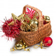 Christmas decorations in basket - Stock Photo