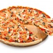 Delicious Pizza with seafood with the cut off slice — Stock Photo