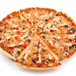 Pizza with the cut off slice — Stock Photo