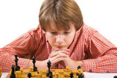 Boy playing chess — Stock Photo